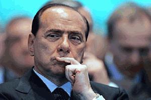 Nad Berlusconija z vudu magijo